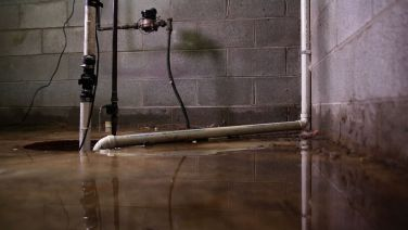 Faulty sump pump in flooded basement