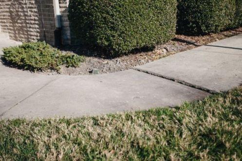 Sinking concrete sidewalk
