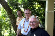 Fr. Marc Roselli, SJ, superior of Jesuit Community of Chuuk, Fr. David Ciancimino, SJ, and Fr. Richard McAuliff, SJ, director of Xavier High School, pose for a photo. Flower headpieces are traditionally presented to visitors in celebration of their arrival.
