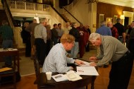 Ed Delaney, the head promoter for the weekend and president of the Fr. Shealy retreat guild helps with registration.