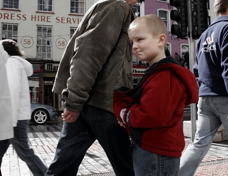 A boy on St. Patrick's Street