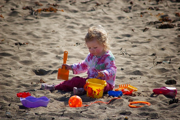A child playing in the sand