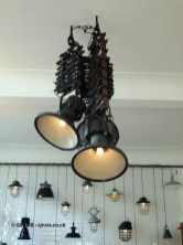 Steampunk style hanging lights at The Corner Room