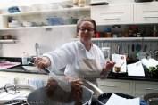 Ann Colquhoun picking up crab at Fish in a Day, Food Safari