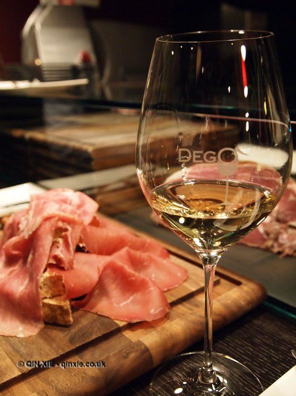 Charcuterie and Franciacorta wine glass at Dego, London