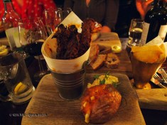 Bucket of ribs with cheddar baked potato, apple slaw and chips at Fox and Anchor, Clerkenwell