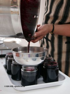 Pouring jam into jars, jam making with Vivien Lloyd