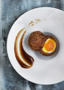 Smoked venison Scotch egg with espresso brown sauce
