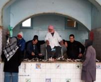 Bidding chair at fish market, Tunisia