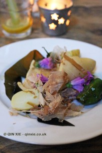 Braised squid, padron peppers, wine-braised kombu, bonito, pickled potatoes, James Ramsden's Secret Larder Supper Club