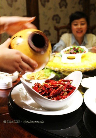 Dry fried chicken with chillies served in a gourd, Kuan Alley No 3, Chengdu, China