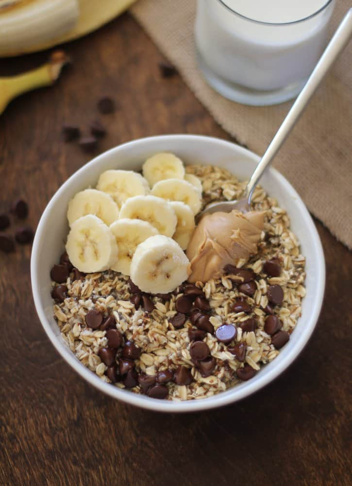 Homemade Instant Oatmeal in a bowl with bananas, peanut butter and chocolate