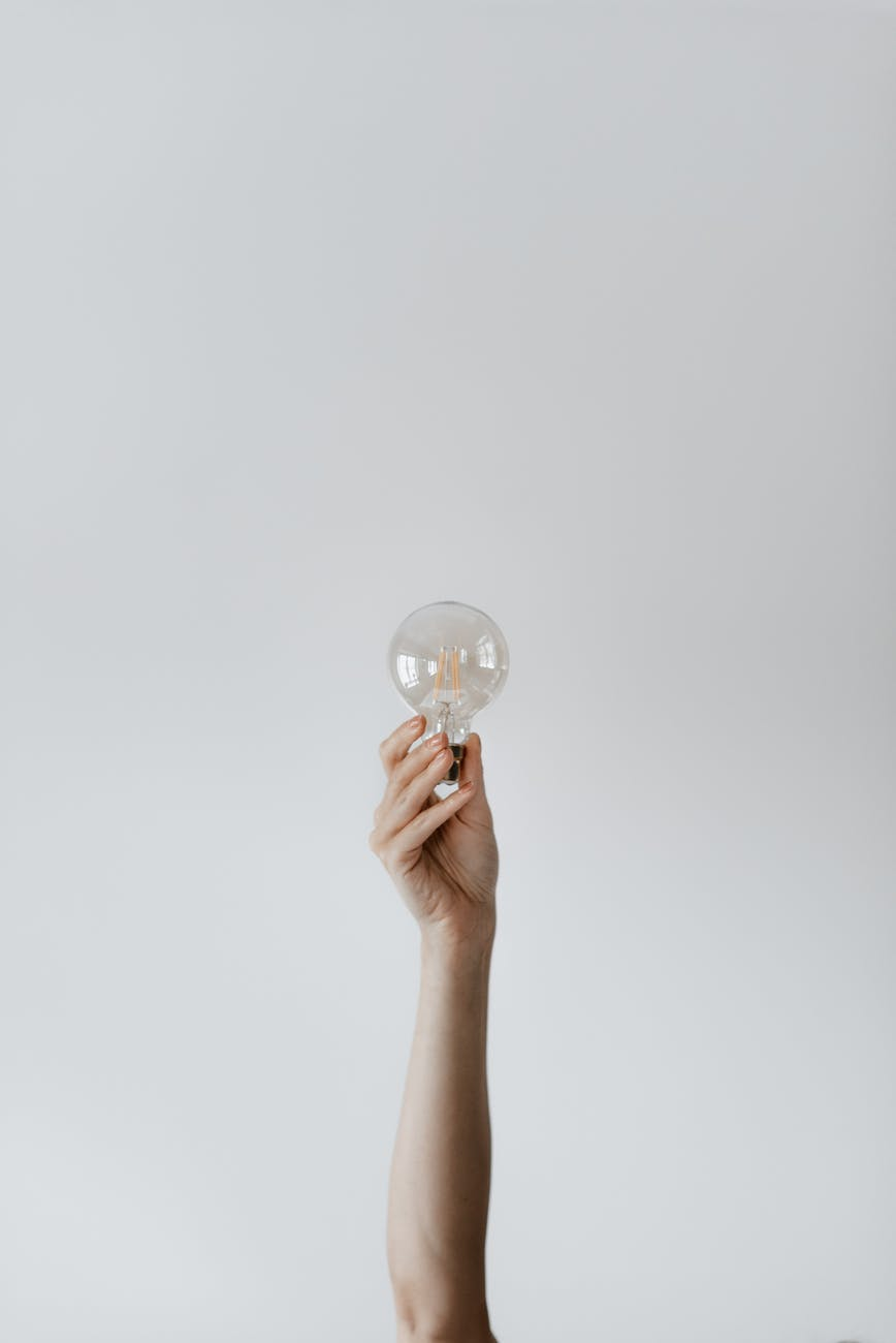 anonymous female showing light bulb