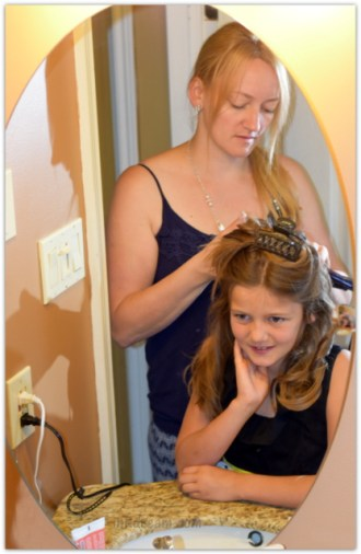 Building a mother daughter bond with a little girls hair do.