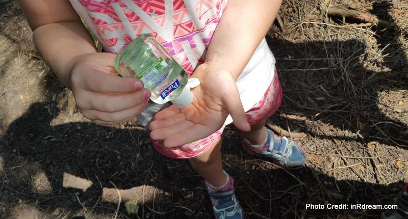 Child using Purell