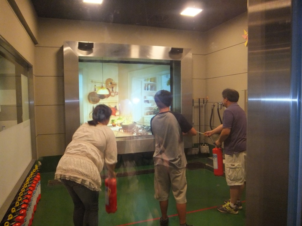 Putting out a simulated fire at Saitama Prefectural Learning Disaster Center in Konosu