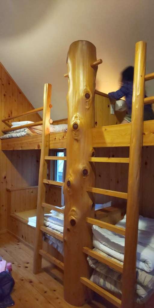 Picture of bunk beds in the two storey log cabins of Yoshida Genki mura Peach blossoms Chichibu Rocket Town Biomass facility log cabins Kakkaku Dam
