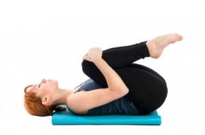 Apanasana or posture of the knees to the chest.