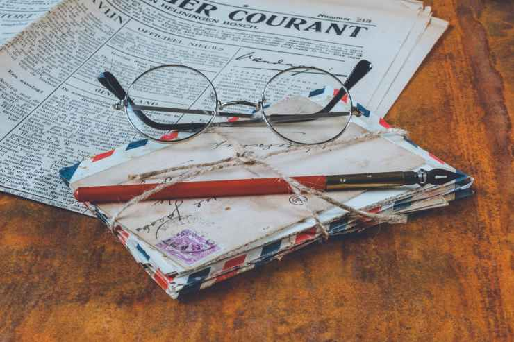 letters and an eyeglass on table