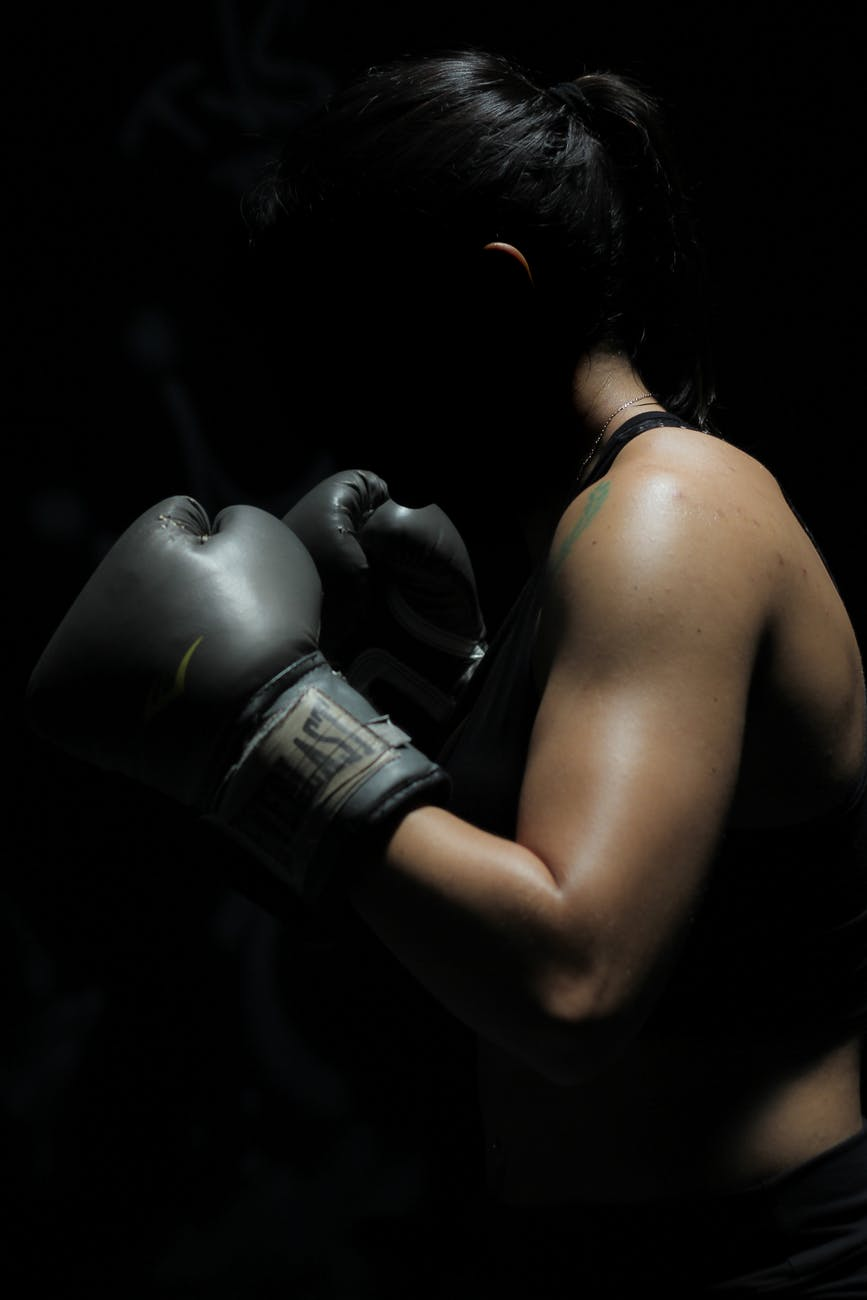photo of woman in boxing gloves