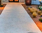 attractive-landscaping-ideas-with-paver-walkways-and-garden-lighting-also-front-porch-with-grain-silo-homes-and-faux-stone-siding-and-glass-windows