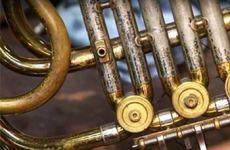 Close up of keys on brass instrument.