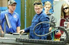 Students working on machine.