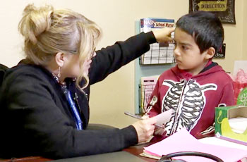 School nurse with a young student.