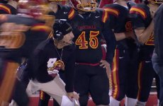 Oakdale High School football coach, Trent Merzon coaching game.