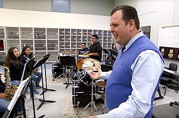 Teacher of the year, brian mcdaniel, with his music class