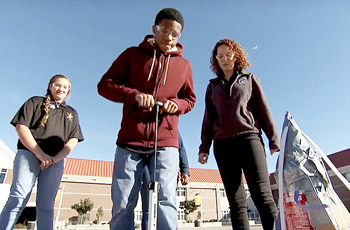 Pittsburg High School students launching an experiment outdoors.