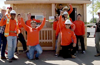 Lincoln high school students standing in front of construction project for competition