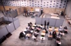 students attending classroom inside makeshift class inside warehouse