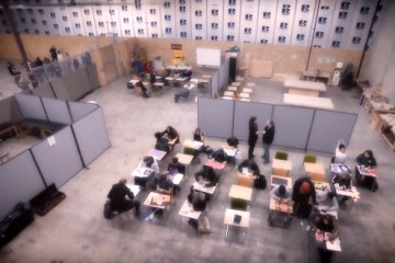 students attending classroom inside makeshift class inside warehouse