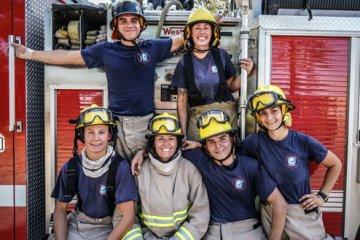 firefighters sitting on fire truck