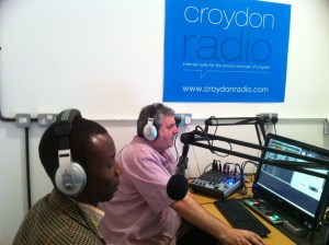 Station founder Tim Longhurst (pink shirt) at the controls for an early Croydon Radio show