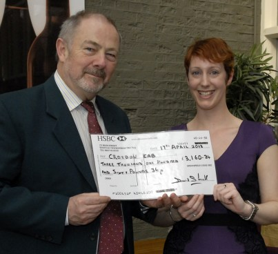 Good deed: Jess Sumner receives the donation cheque from