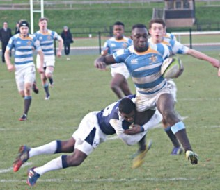 Tackled: despite losing position here, Trinity School's first XV did enough at Harrow before Christmas to earn a NatWest Cup sixth-round tie at Dulwich College