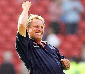 Get in there: Neil Warnock celebrates landing the Palace manager's job. Allegedly