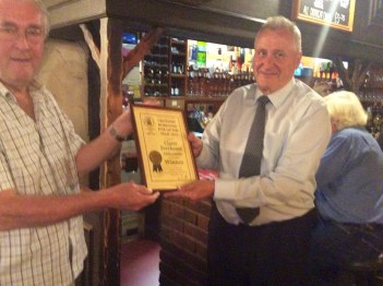 Feeling flushed: Clarets' landlord, Don Burton, right, collects another CAMRA pub of the year award