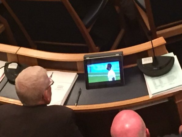 Own goal! Pat Ryan, himself a former Mayor, left, and the bald pate of John Wentworth, caught watching Palace during a council meeting. Might that make him worthy material for Mayor?