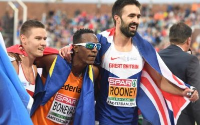Croydon's Martyn Rooney celebrates his victory in Amsterdam last night with the silver and bronze medallists