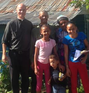 """Madelin (front right) is from the mountain village of Billiguín, about 2 1/2 hours from the town of Bánica;,"" says Father Keith. ""She is a college freshman and is studying to be an elementary school teacher; she is pictured here with her parents and two of her five siblings. It costs $300/month to sponsor a student."""