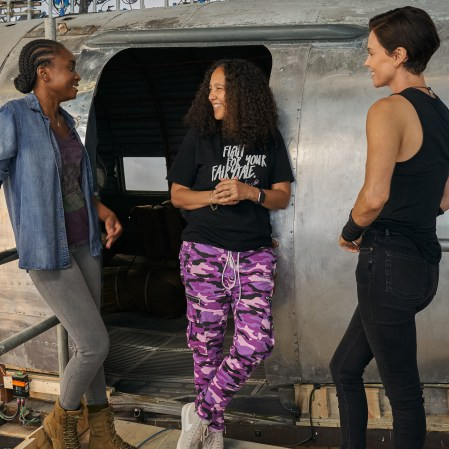 "KiKi Layne, director Gina Prince-Bythewood and Charlize Theron on the set of ""The Old Guard."" (Photo courtesy of Netflix)"