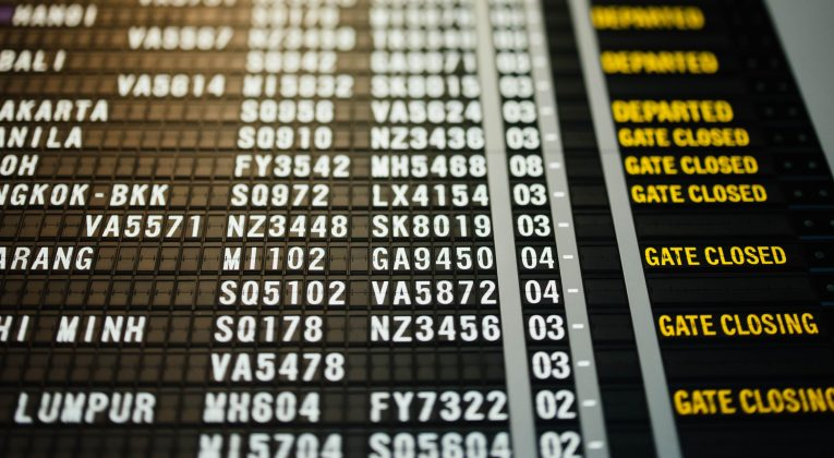 Departure / Arrivals display at the airport (Source: Chuttersnap / Unsplash)