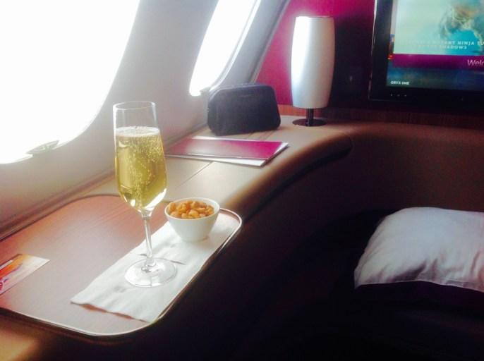 qatar airways, first class, a380, champagne