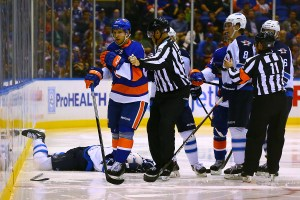 Nikolai Kulemin gets escorted away from Brad Stuart  after checking him into the boards. (Brandon Titus/Inside Hockey)