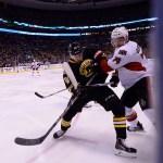 Dec 13, 2014; Boston Bruins left wing Craig Cunningham (61) and Ottawa Senators defenseman Mark Borowiecki (74) during an NHL game in the TD Garden in Boston. (Photo: Brian Fluharty)