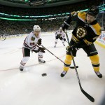 Boston Bruins defenseman Dennis Seidenberg (44) clears the puck out of the corners.