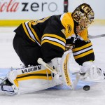 Boston Bruins goalie Tuukka Rask (40) covers the puck.